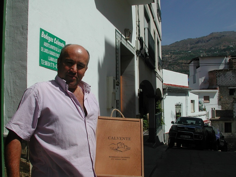 Horacio Calvente in front of the gates at his winery in the village of Jete.